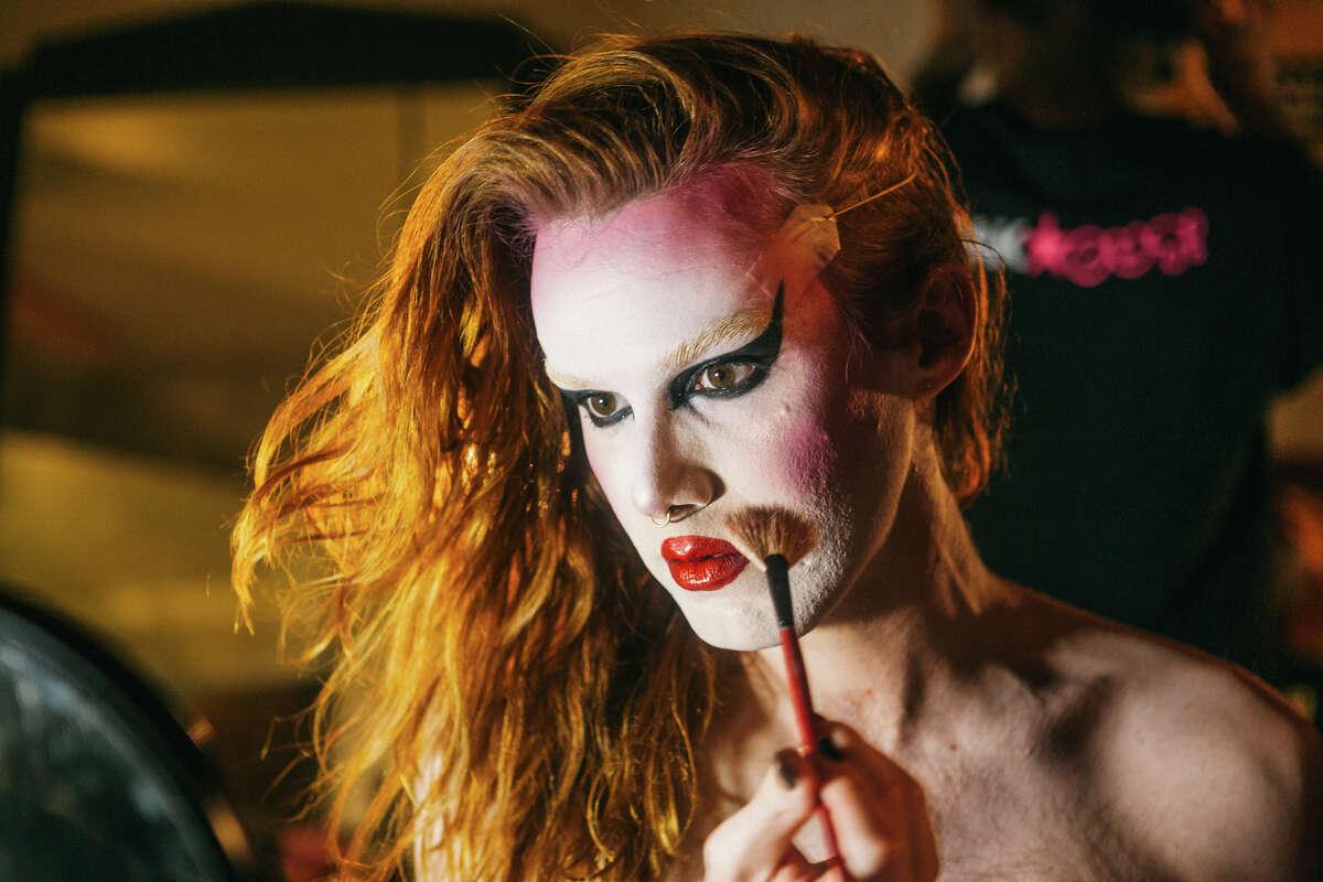St. Nastine applies makeup backstage.