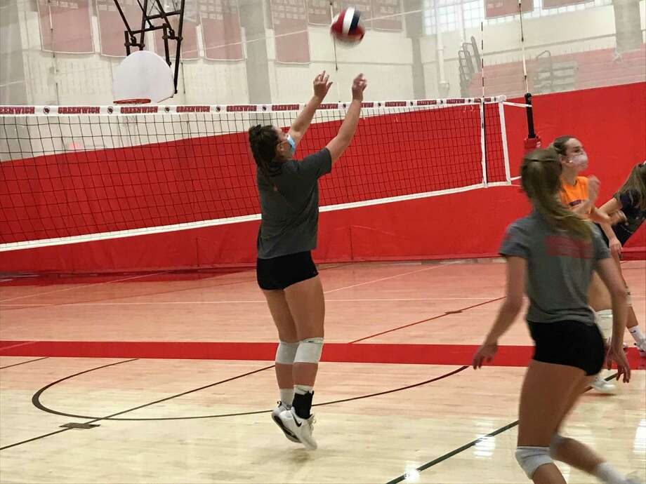 Lilly Saleeby sets the ball during volleyball practice at Greenwich High School on Tuesday, Sept. 29, 2020. Saleeby is a senior captain of the Cardinals' girls volleyball team. Photo: David Fierro /Hearst Connecticut Media
