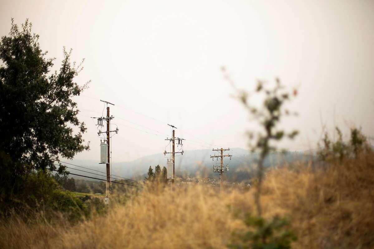 Power lines, brush and hazy sky in Santa Rosa.