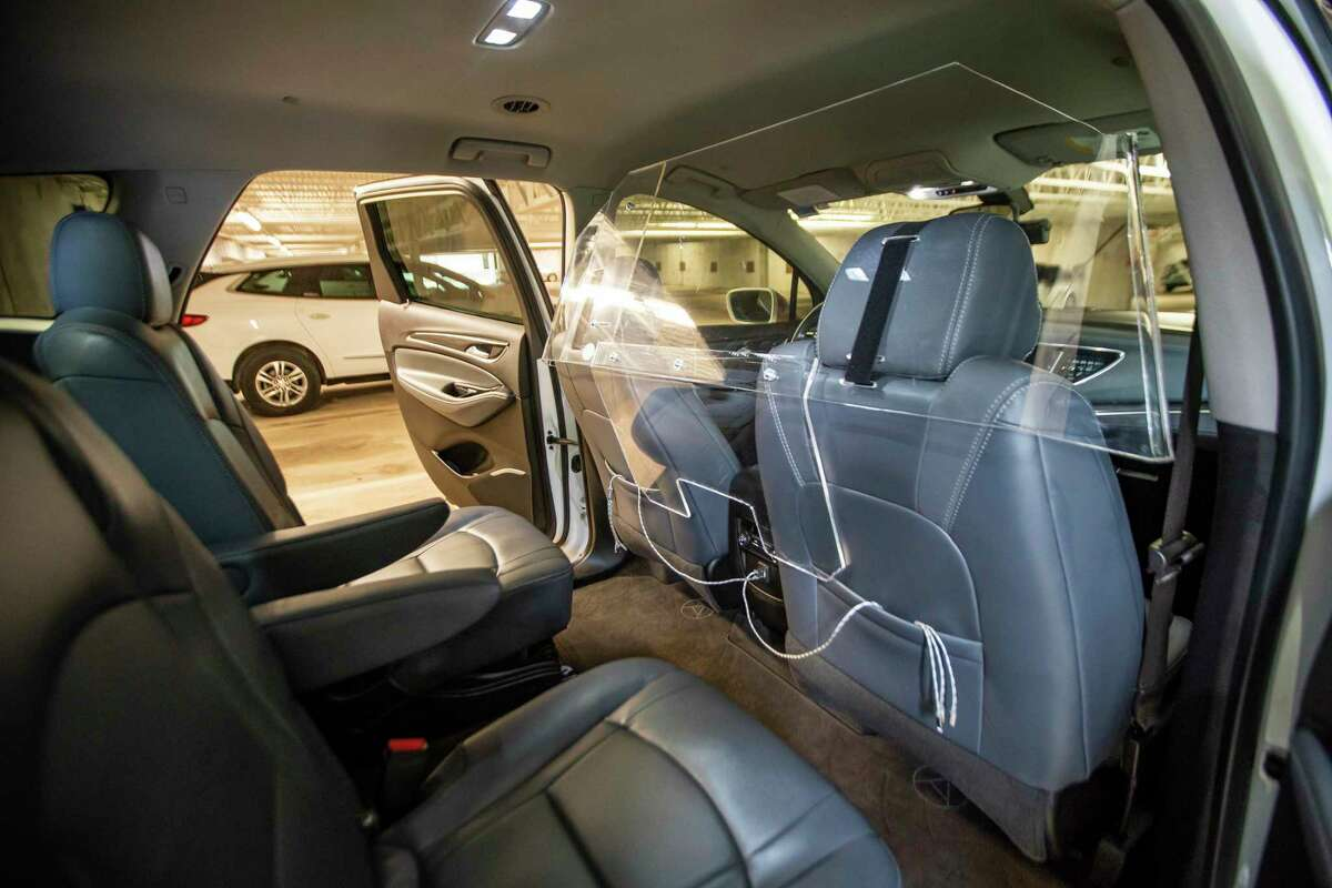 ALTO, a Dallas-based company, is rolling out a new ride-hailing service in Houston this week. The company uses uniform vehicles, a fleet of Buick Enclaves photographed Wednesday, Sept. 23, 2020, in Houston. The interiors have a plexiglass barrier installed inside between the driver and passengers.