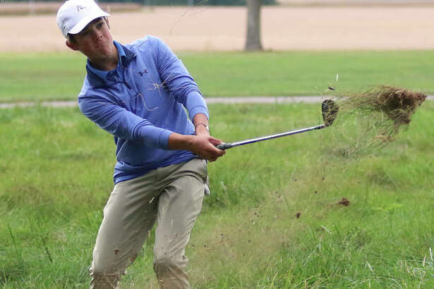 After finding a handful of abandoned golf balls before his own, Carlinville sophomore Henry Kufa hits out of the weeds Tuesday afternoon in the South Central Conference Tournament at Indian Springs golf course in Fillmore. Kufa shot 81 to place sixth and repeat as an All-SCC golfer.