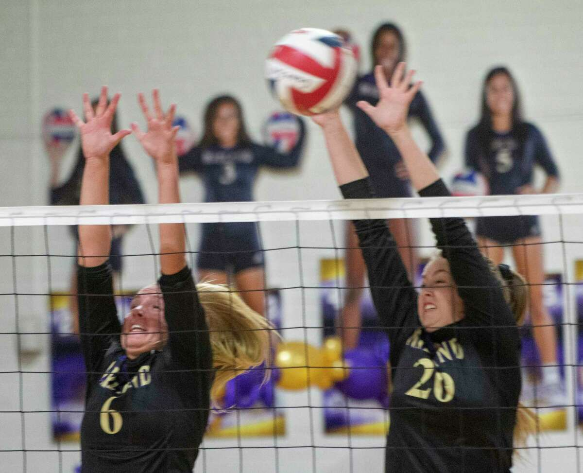Midland High's Olivia Harper and Grace Utter go up for a block 09/29/2020 against Odessa High at the Midland High gym. Tim Fischer/Reporter-Telegram