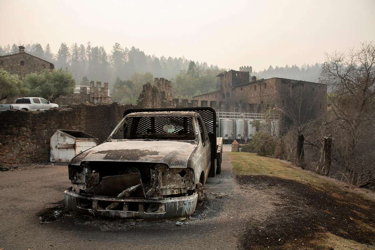 A burned car stands in front of the back stock building at Castello di Amorosa during the Glass Fire in Calistoga on Tuesday.