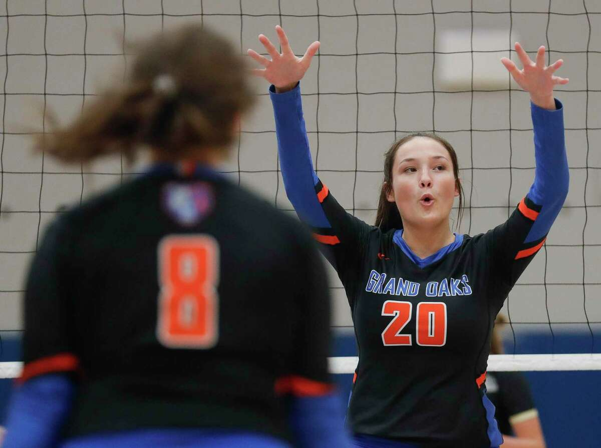 Grand Oaks middle blocker Kailee Blanchard (20) reacts after blocking a shot by Summer Creek right side hitter Kaitlyn Honora during a non-district high school volleyball match at Grand Oaks High School, Tuesday, Sept. 29, 2020, in Spring.