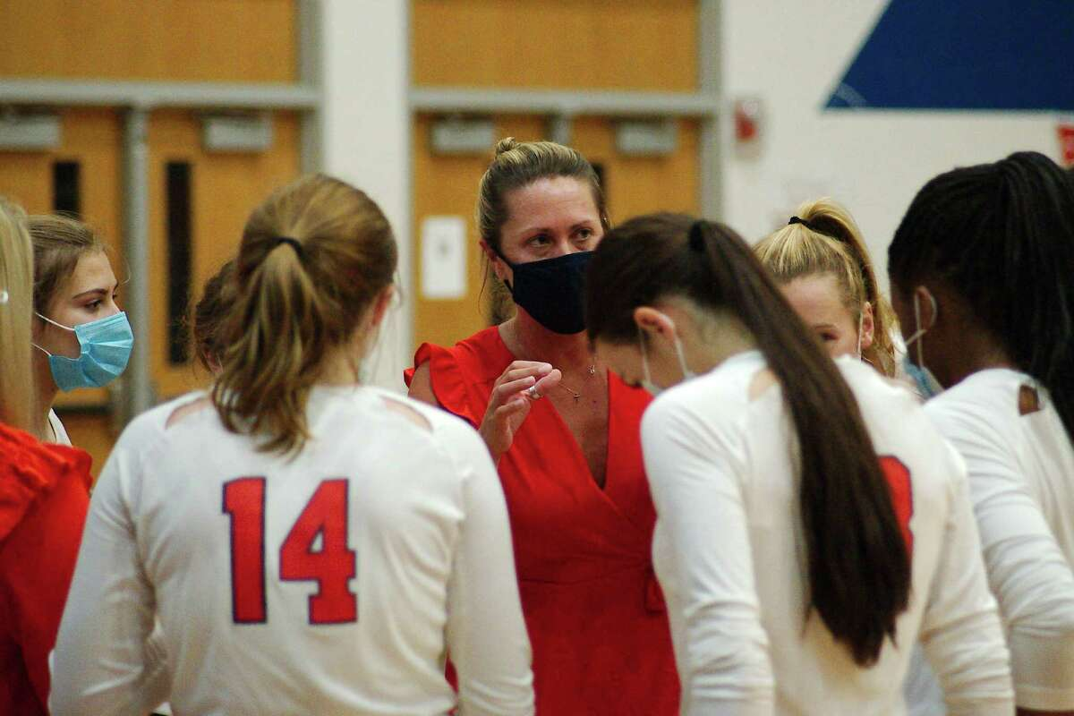Clear Lake volleyball coach CiCi Anderson speaks to her team during a break against Clear Brook Tuesday, Sep. 29 at Clear Lake High School.