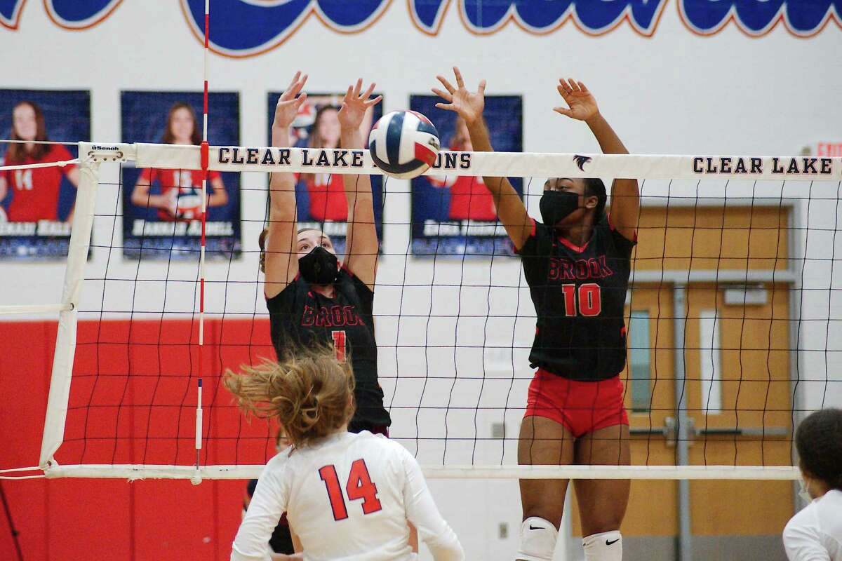 Clear Brook's Samantha Saladrigas (1) and Clear Brook's Simone Lenoir (10) go high to block a shot by Clear Lake's Kenadi Hall (14) Tuesday, Sep. 29 at Clear Lake High School.