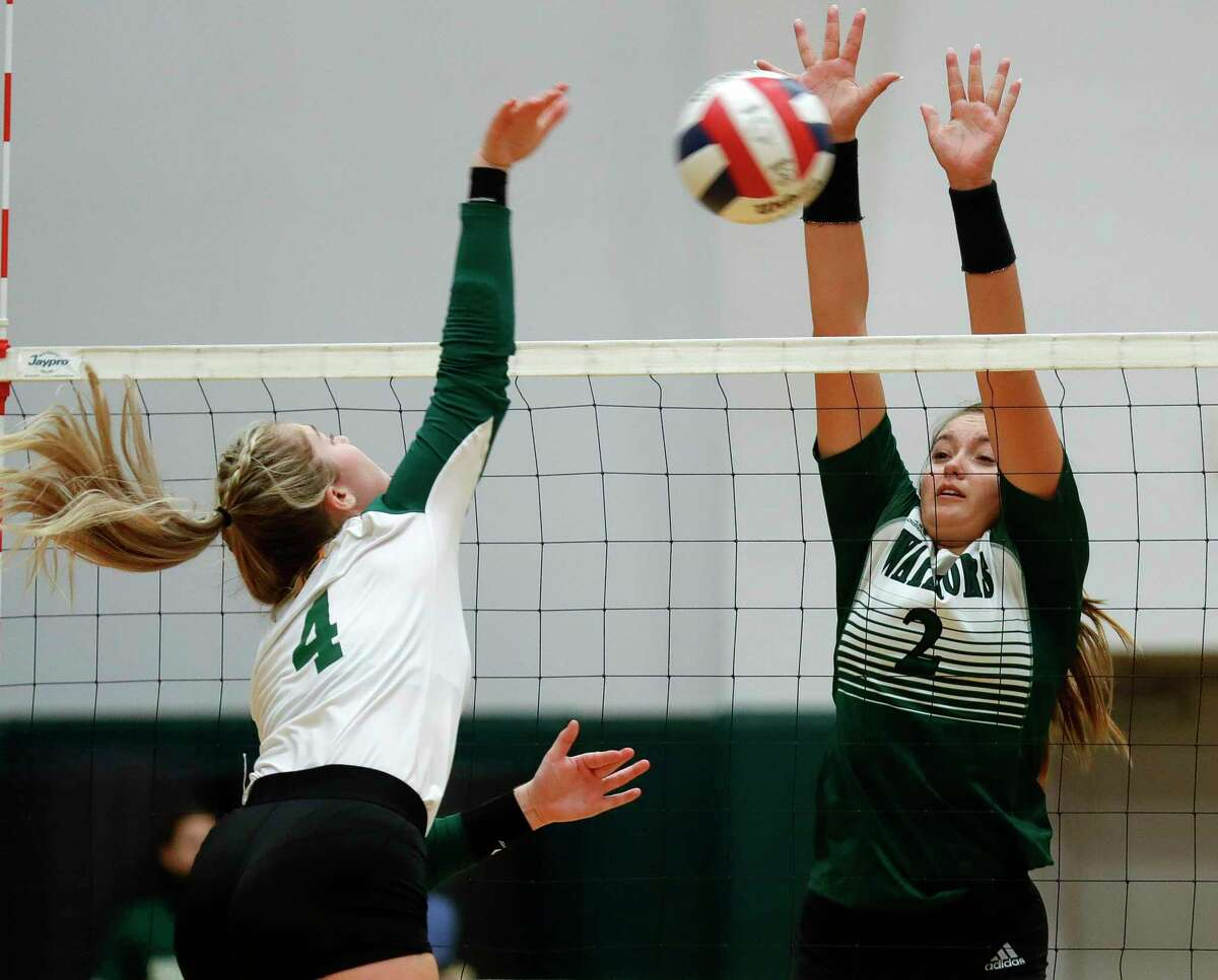 The Woodlands Christian Academy setter Claire Dewine (2) blocks a shot by Fort Bend Christian Academy outside hitter Caitlyn Harraman (4) during the second set of a TAPPS high school volleyball match at The Woodlands Christian Academy, Tuesday, Sept. 29, 2020, in The Woodlands.