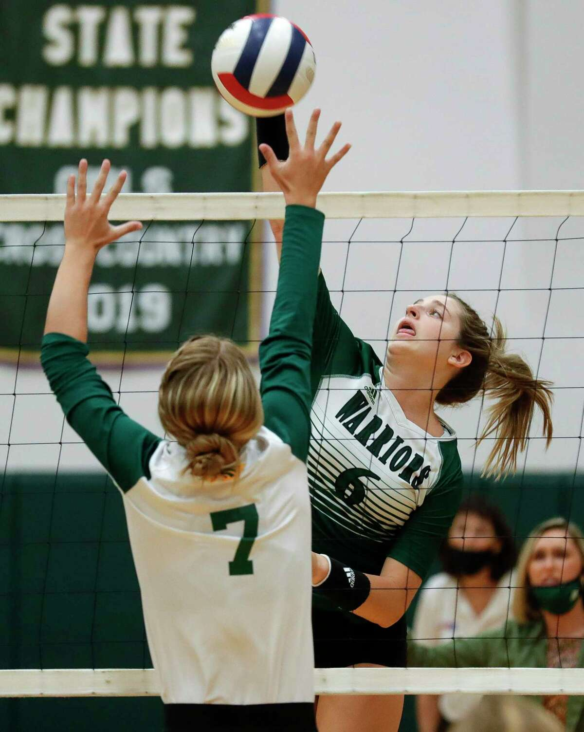 The Woodlands Christian Academy outside hitter Abby Adams (6) gets a shot past Fort Bend Christian Academy setter Reagan Heflin (7) during the first set of a TAPPS high school volleyball match at The Woodlands Christian Academy, Tuesday, Sept. 29, 2020, in The Woodlands.