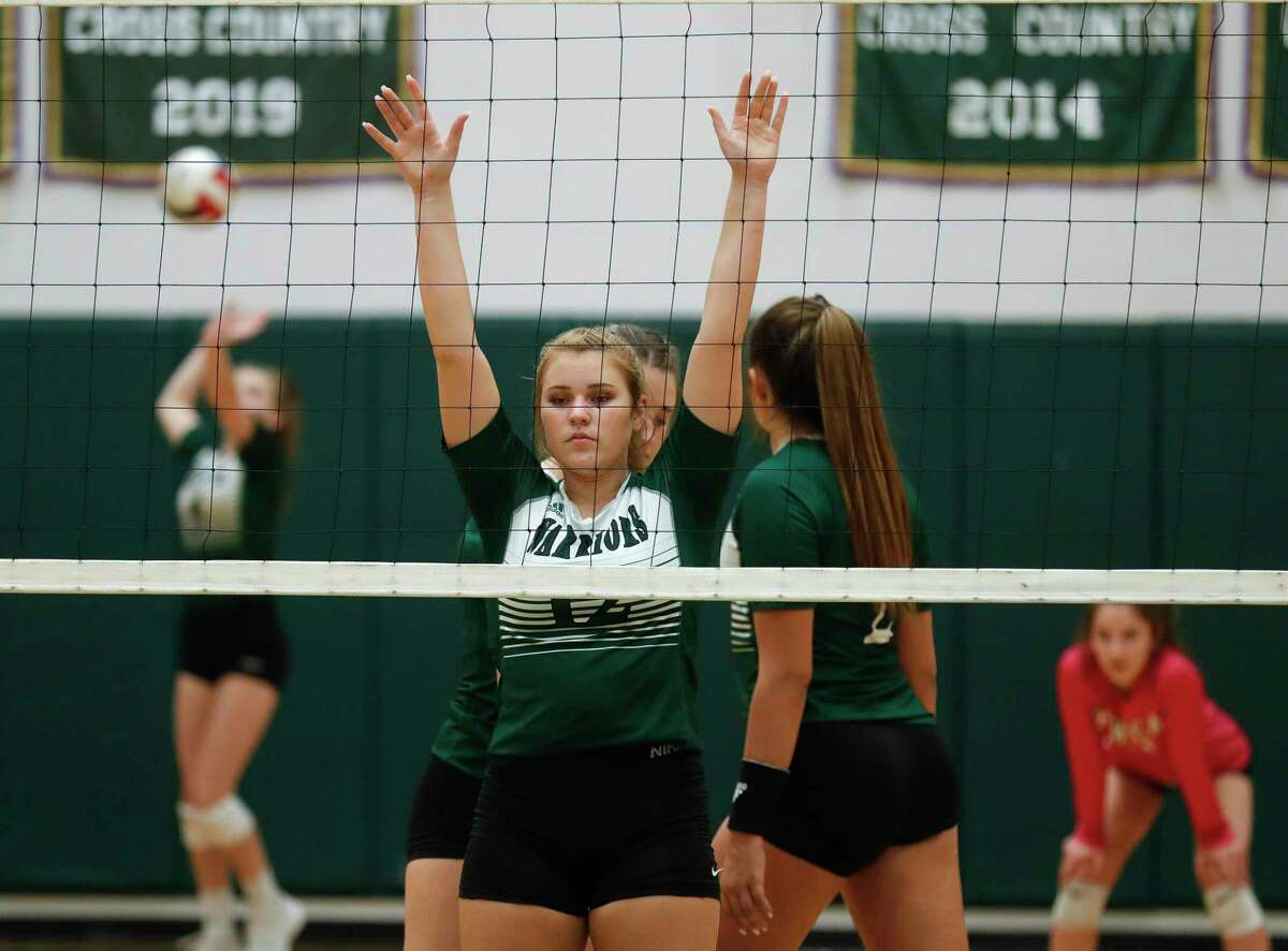 The Woodlands Christian Academy middle hitter Katie Tucker (12) awaits a serve during the second set of a TAPPS high school volleyball match at The Woodlands Christian Academy, Tuesday, Sept. 29, 2020, in The Woodlands.