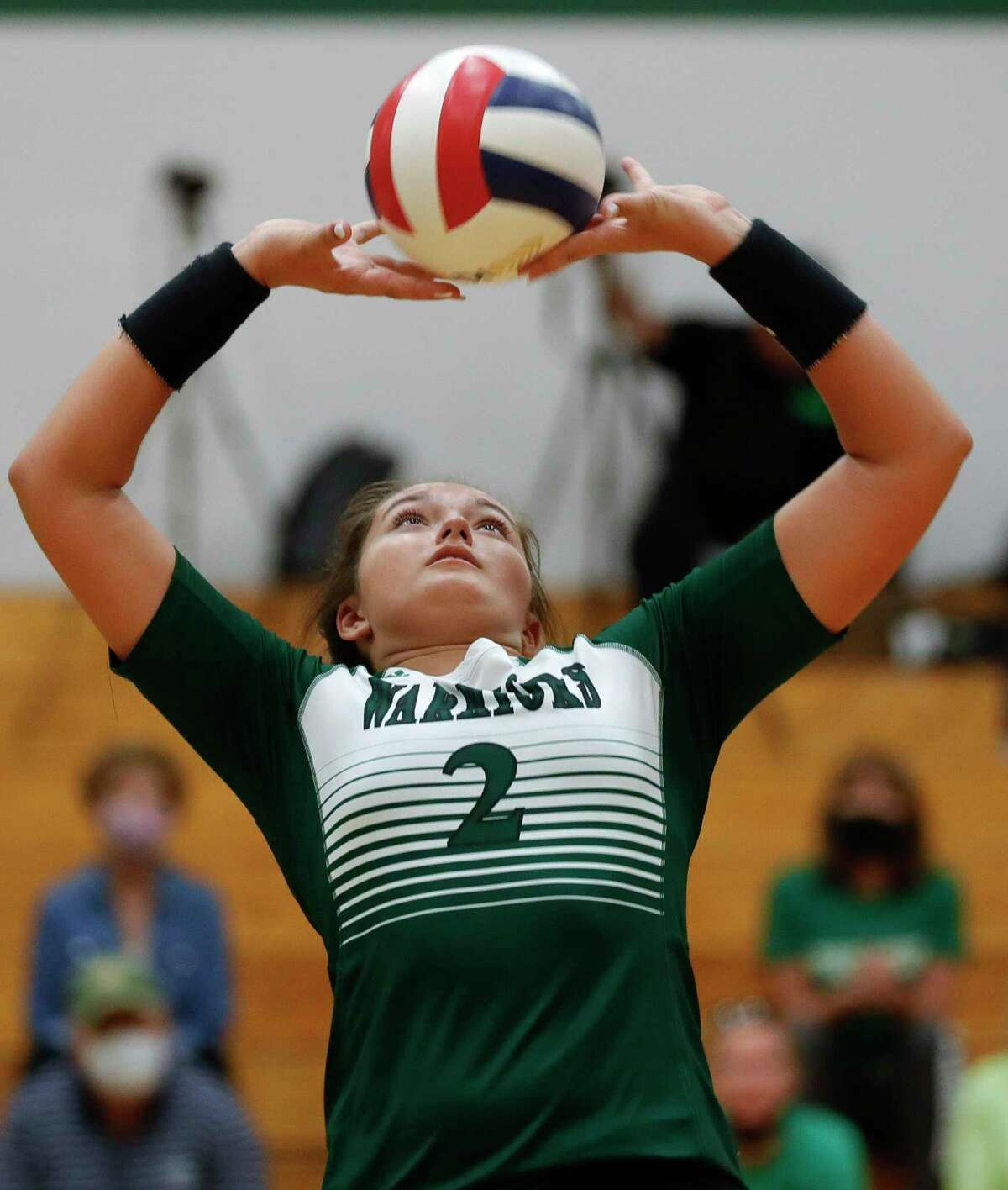 The Woodlands Christian Academy setter Claire Dewine (2) sets the ball during the second set of a TAPPS high school volleyball match at The Woodlands Christian Academy, Tuesday, Sept. 29, 2020, in The Woodlands.