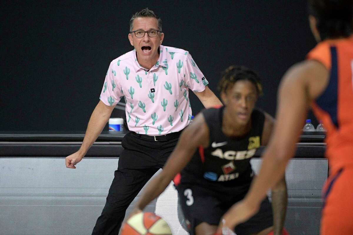 Connecticut Sun head coach Curt Miller, rear, calls out instructions as Las Vegas Aces guard Danielle Robinson (3) sets up a play during the first half of Game 5 of a WNBA basketball semifinal round playoff series, Tuesday, Sept. 29, 2020, in Bradenton, Fla. (AP Photo/Phelan M. Ebenhack)