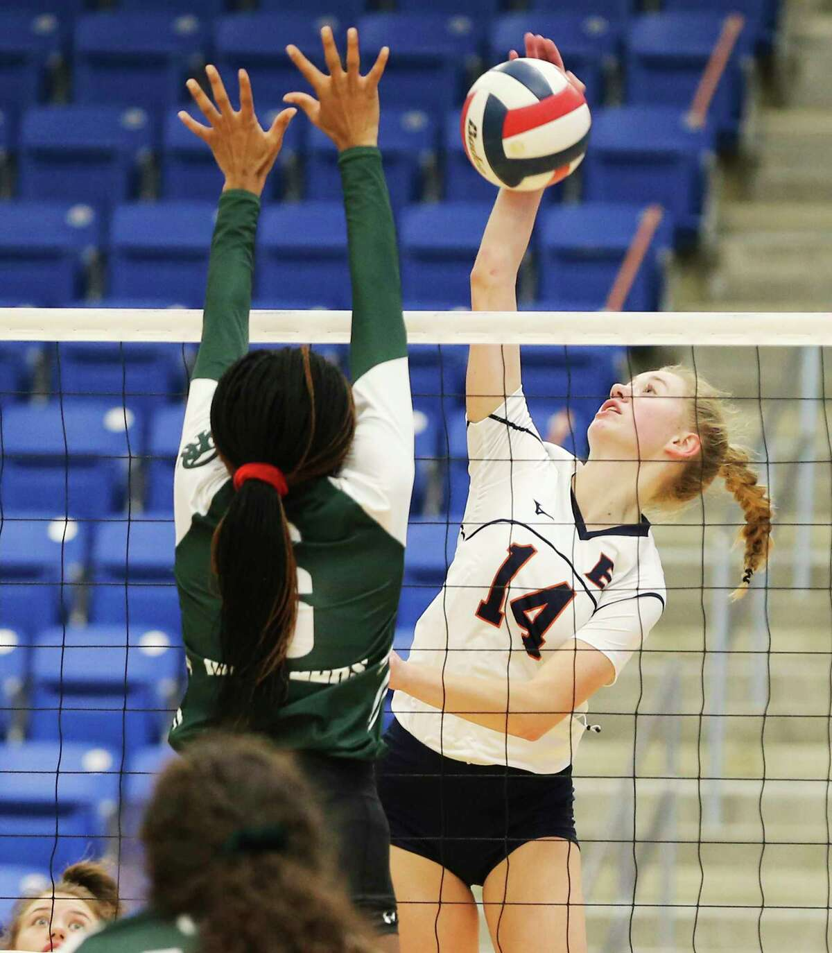 Brandeis' Emma Halstead (14) against Reagan's Chichi Ozigbo (06) during their girls volleyball game at Northside Sports Gym on Tuesday, Sept. 29, 2020. The Broncos defeated the Rattlers, 4-1, to take the contest.