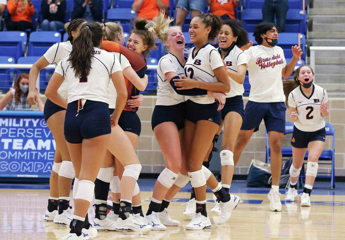 The Brandeis Broncos volleyball team erupts after the final point in celebration and defeating Reagan at Northside Sports Gym on Tuesday, Sept. 29, 2020. The Broncos defeated the Rattlers, 4-1, to take the contest.