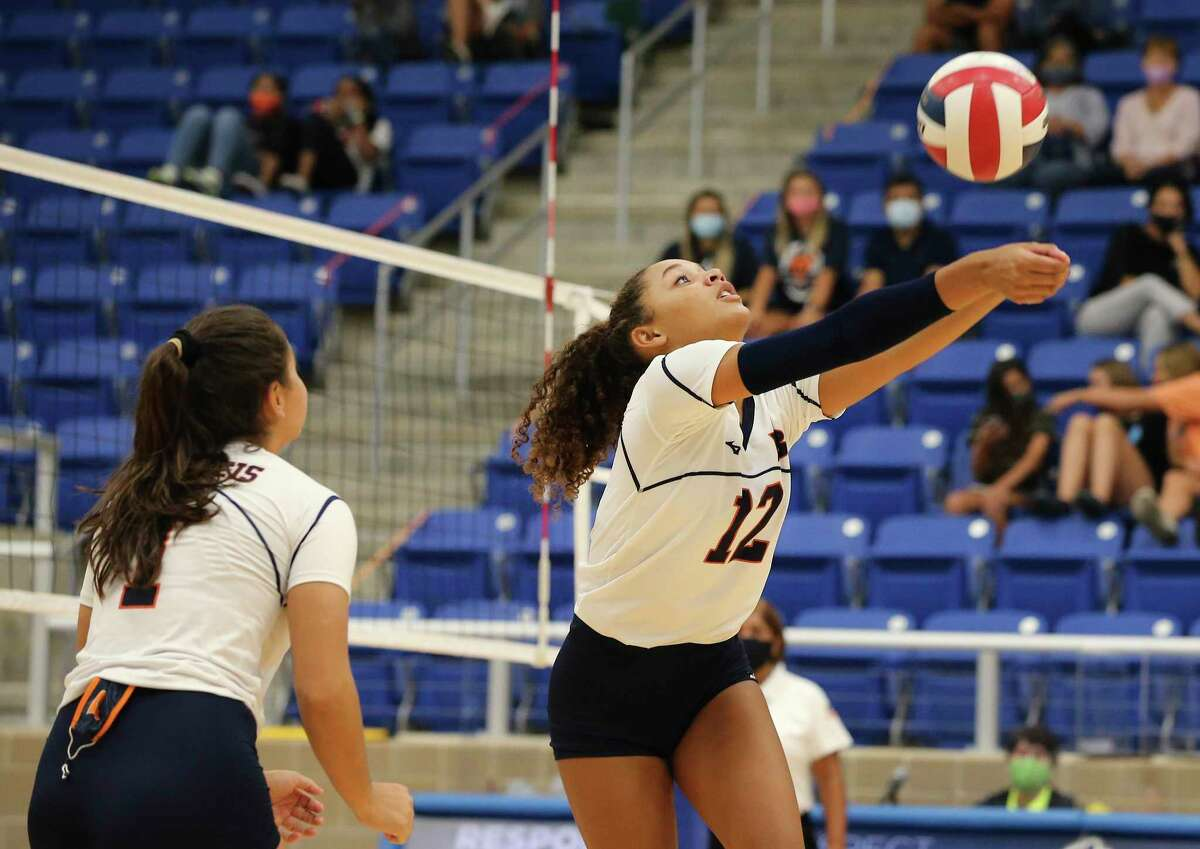 Brandeis' Jalyn Gibson (12) retrieves a shot against Reagan during their girls volleyball game at Northside Sports Gym on Tuesday, Sept. 29, 2020. The Broncos defeated the Rattlers, 4-1, to take the contest.