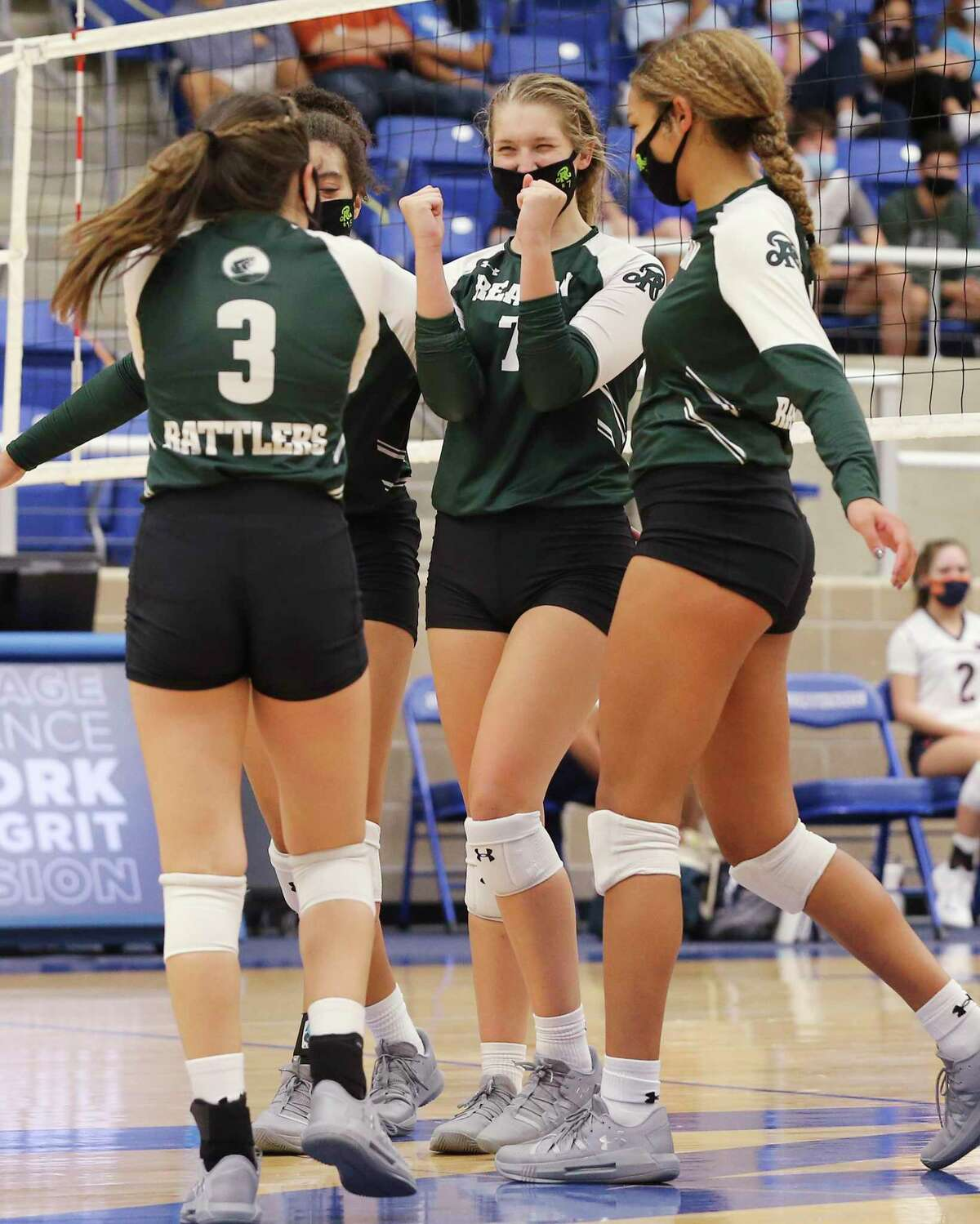 Reagan players celebrate a point against Brandeis during their girls volleyball game at Northside Sports Gym on Tuesday, Sept. 29, 2020. The Broncos defeated the Rattlers, 4-1, to take the contest.