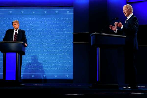 President Donald Trump watches as former vice president Joe Biden speaks during the first presidential debate at Case Western Reserve University in Cleveland on Tuesday night.