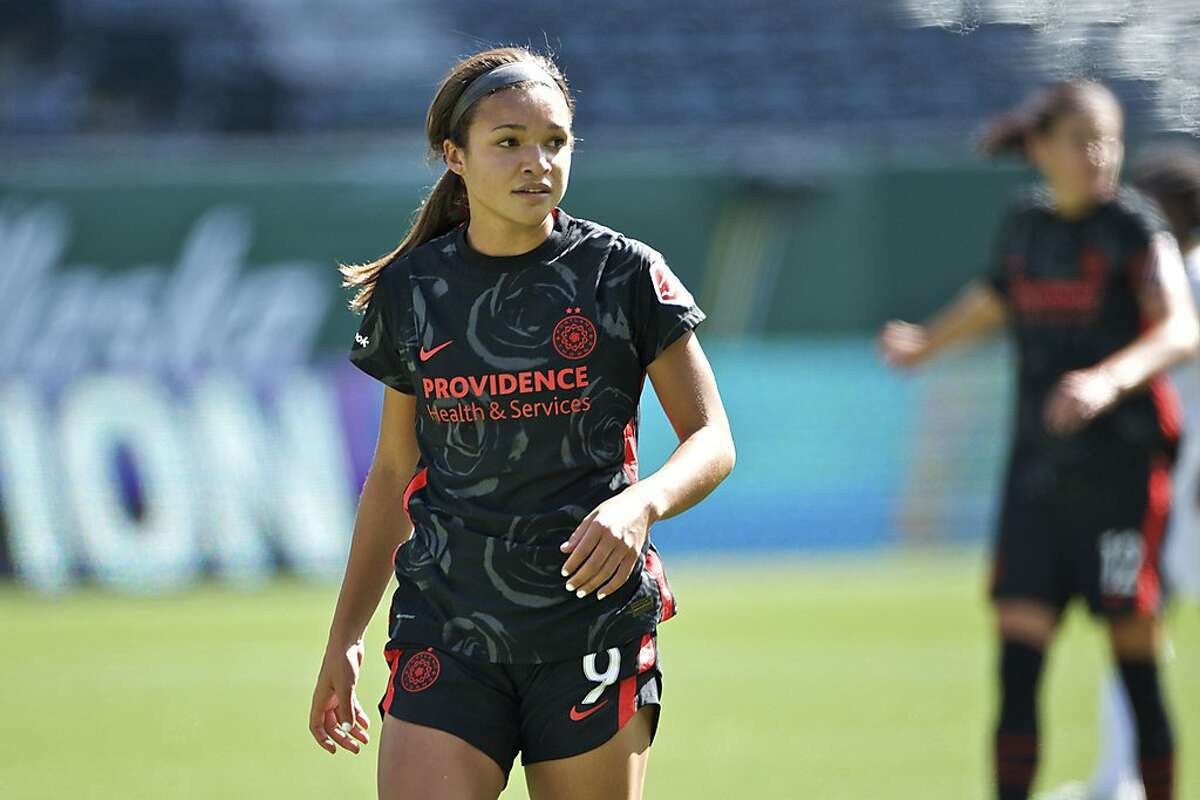 In this photo provided by the Portland Thorns, Portland Thorns' Sophia Smith looks on during an NWSL soccer match against Utah on Sunday, Sept. 20, 2020, in Portland, Ore. The No. 1 pick in the National Women's Soccer League draft and U.S. national team prospect, Smith comes from a family of basketball players - and it was just assumed she'd head in the same direction. Turned out Smith was right to choose soccer. It paved her way to Stanford, and now to a career in the NWSL. (Craig Mitchelldyer/Portland Thorns via AP)