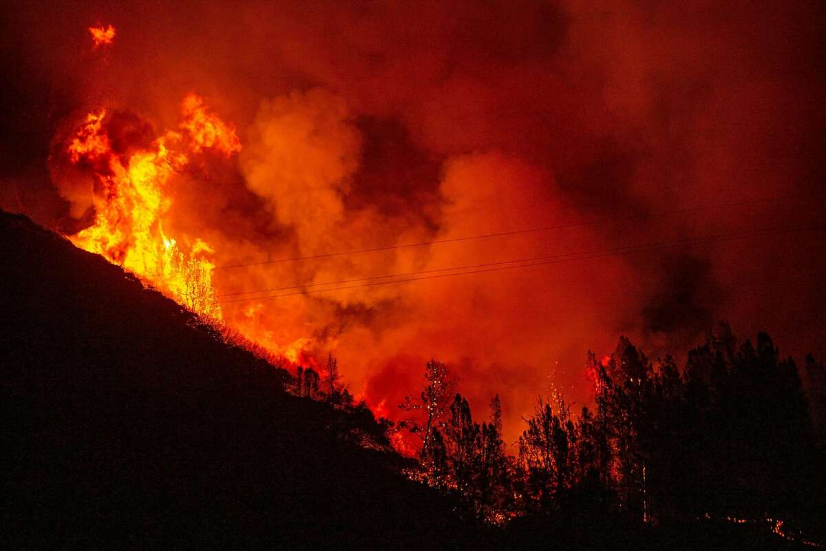 The Glass Fire burns above Rattlesnake Acres off of Highway 29 near Greenwood Avenue, Tuesday, Sept. 29, 2020, in Calistoga, Calif.