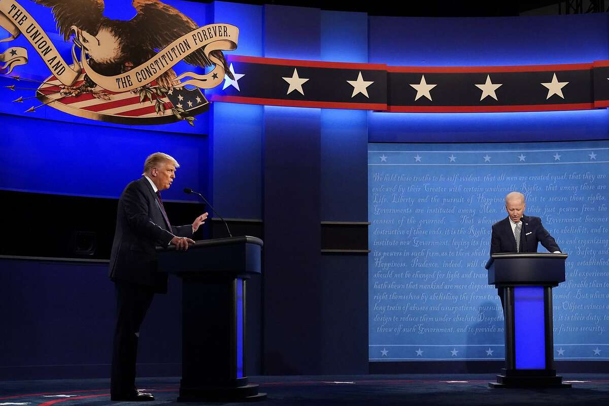 President Donald Trump and Democratic candidate former Vice President Joe Biden participate in the first presidential debate Tuesday, Sept. 29, 2020, at Case Western University and Cleveland Clinic, in Cleveland, Ohio. (AP Photo/Julio Cortez)