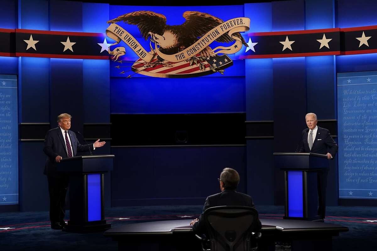 Moderator Chris Wallace of Fox News listens as President Donald Trump and Democratic candidate former Vice President Joe Biden participate in the first presidential debate Tuesday, Sept. 29, 2020, at Case Western University and Cleveland Clinic, in Cleveland, Ohio. (AP Photo/Patrick Semansky)