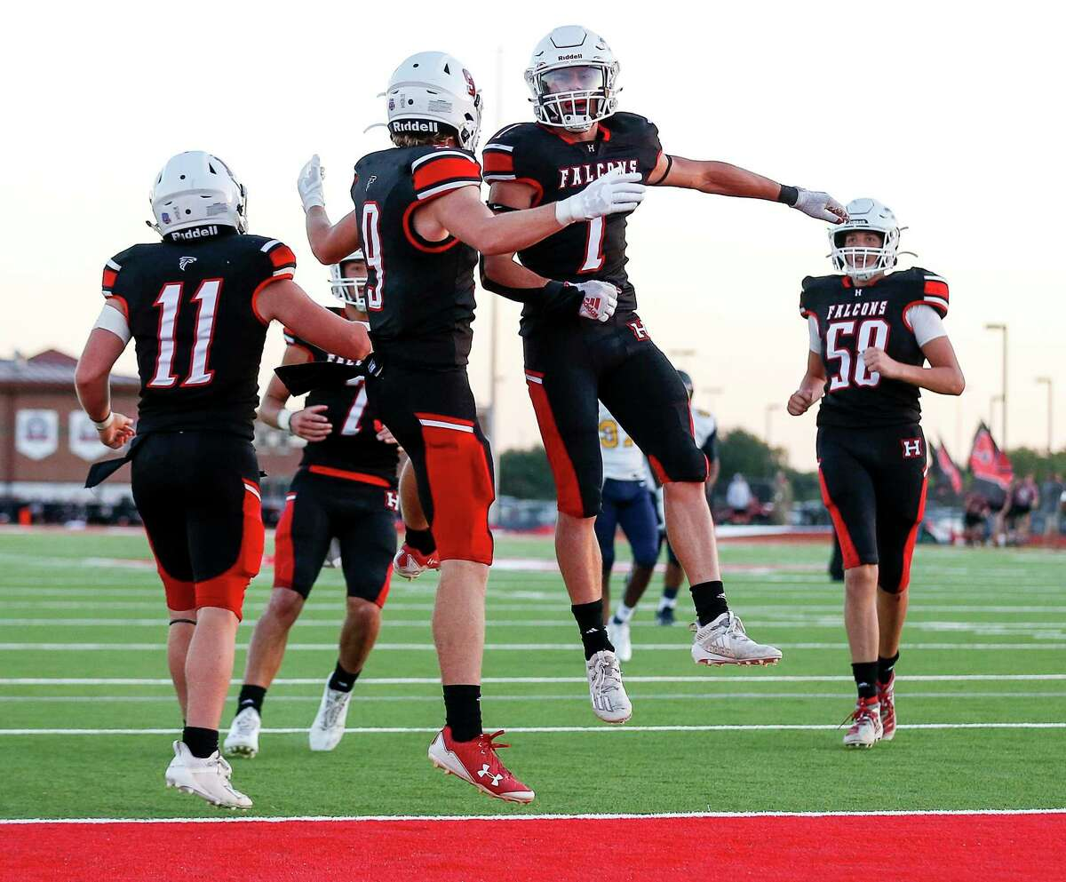 Huffman Falcons wide receiver Gunnar Gates (9) celebrates with quarterback Luke Thomas (7) after he caught a touchdown pass during the first half of a football game Tuesday, Sept. 29 2020, at Huffman Falcon Stadium in Houston.