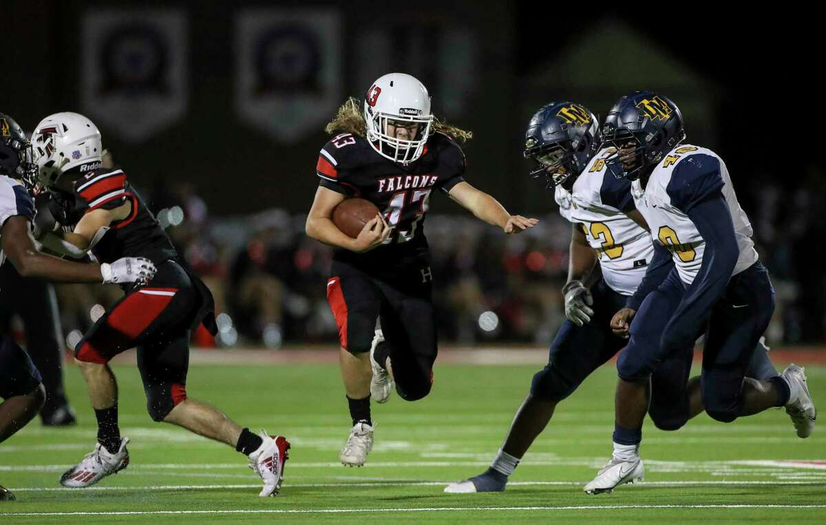 Huffman Falcons running back Holden Campbell (43) rushes past La Marque Cougars Rene Romero (53) and linebacker Ethan Sajna (48) during the second half of a football game Tuesday, Sept. 29 2020, at Huffman Falcon Stadium in Houston.