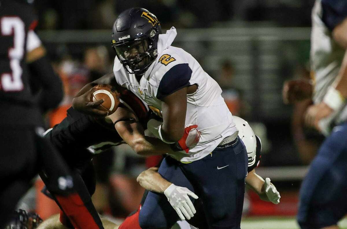 La Marque Cougars quarterback Armond Robinson (2) rushes during the second half of a football game Tuesday, Sept. 29 2020, at Huffman Falcon Stadium in Houston.
