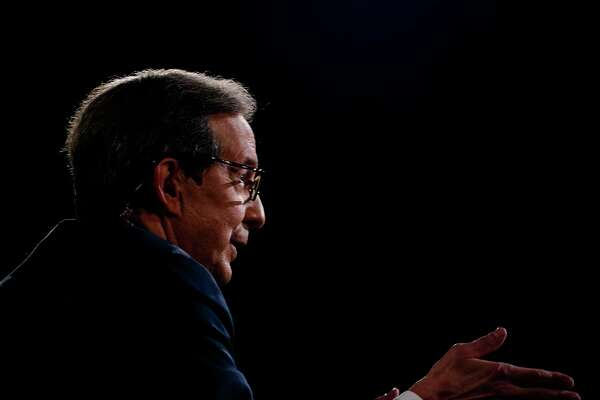 Moderator Chris Wallace speaks to President Donald Trump and former vice president Joe Biden during the first presidential debate at Case Western Reserve University in Cleveland on Tuesday night.