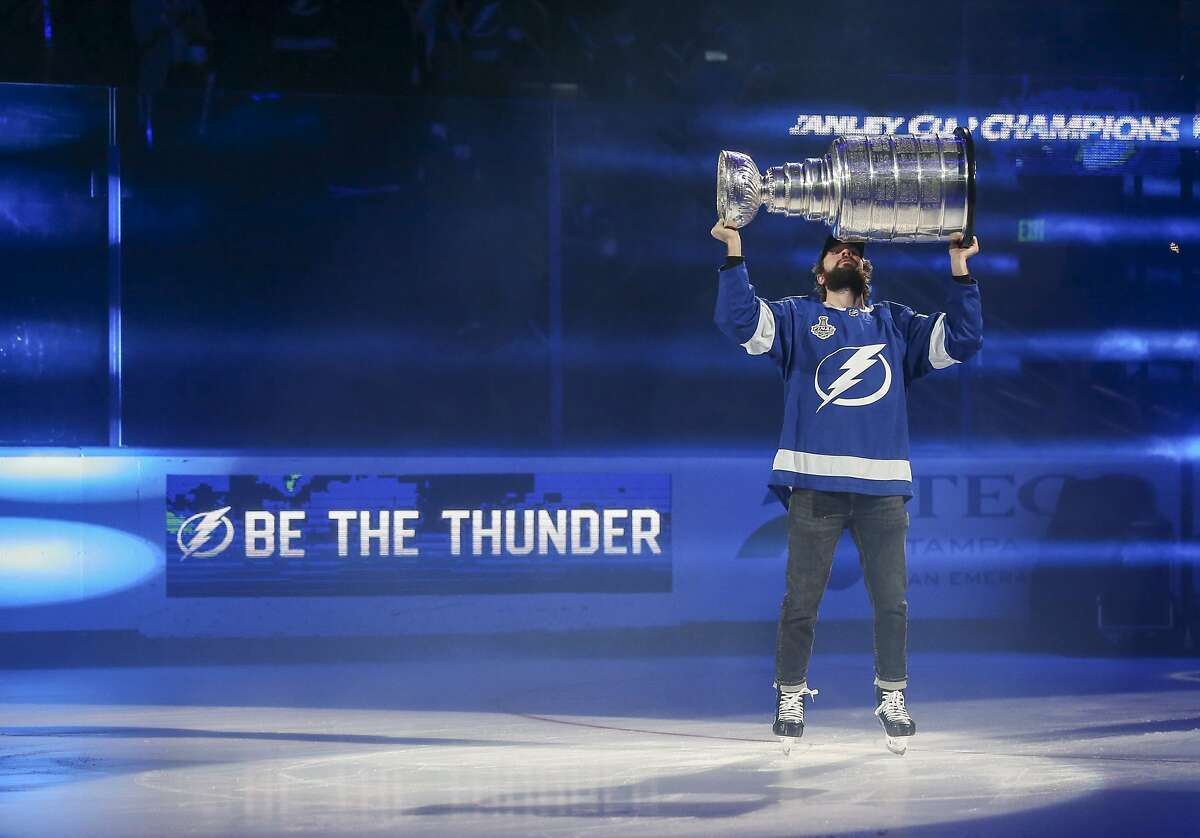 Tampa Bay Lighting's Nikita Kucherov kisses the Stanley Cup while skating around Amalie Arena, Tuesday, Sept. 29, 2020, in Tampa, Fla. (Dirk Shadd/Tampa Bay Times via AP)
