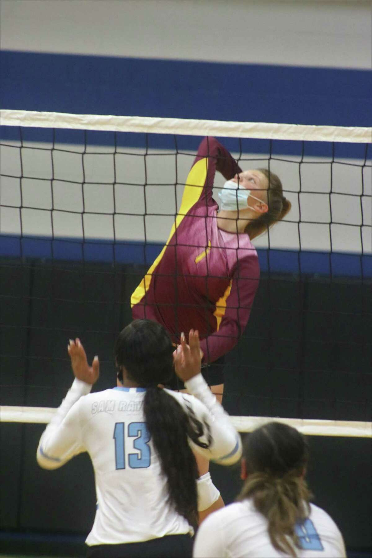 Tatum Busch leaps up, looking for a chance to add to her 14-kill count Tuesday night in the Rayburn gym.