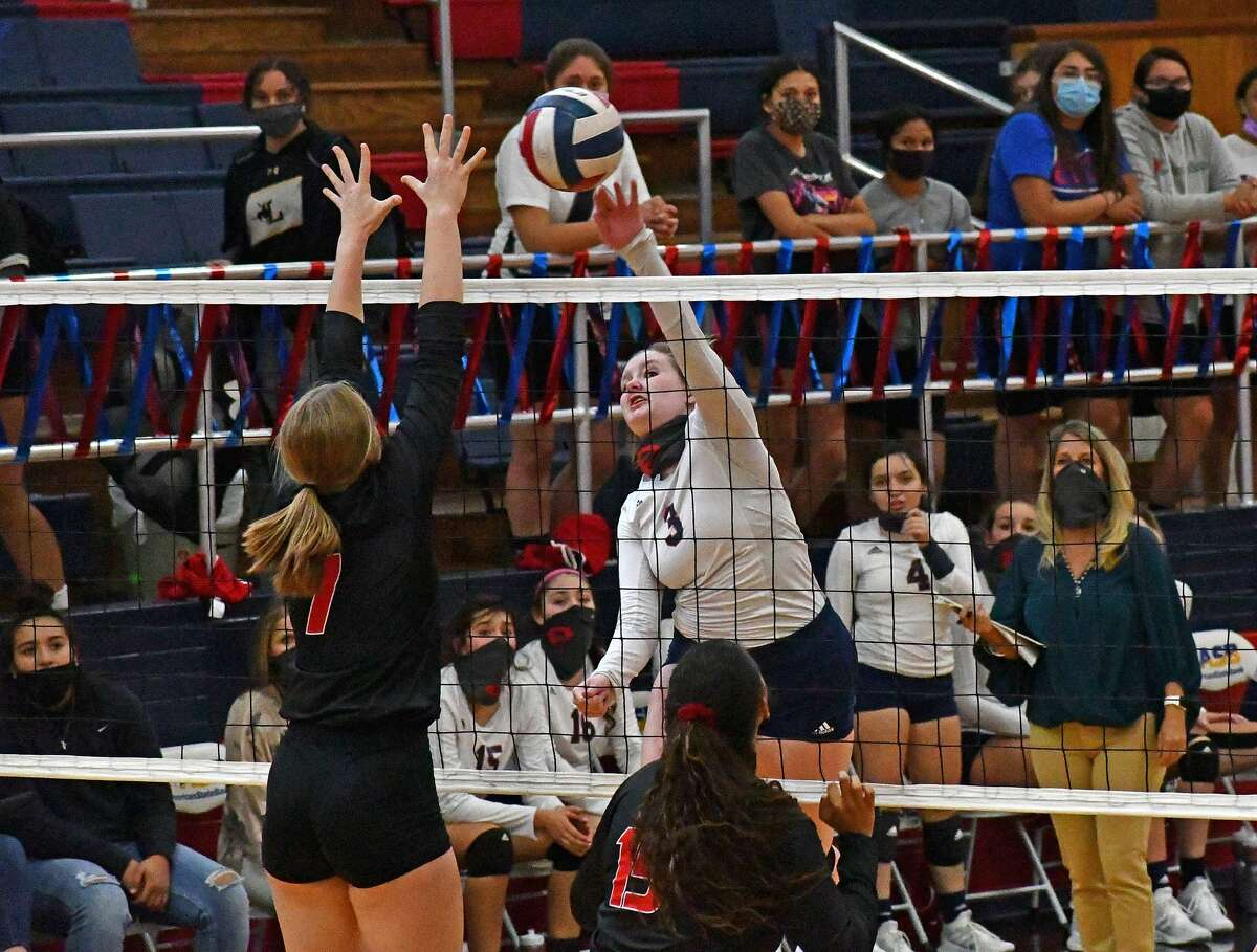 Plainview's Avery Moudy hits the ball past a Wichita Falls defender during their non-district high school volleyball match as part of a triangular on Tuesday, Sept. 29, 2020 in the Dog House at Plainview High School.