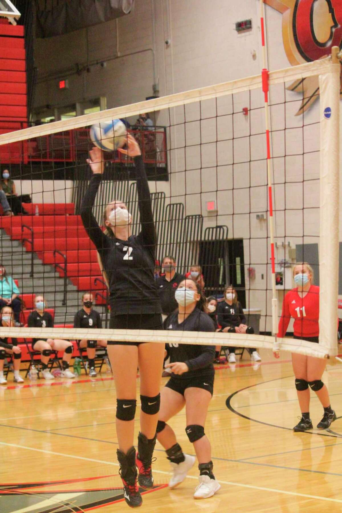 Reed City's Kyleigh Weck (2) works with the ball against Chippewa Hills. (Herald Review photo/John Raffel)