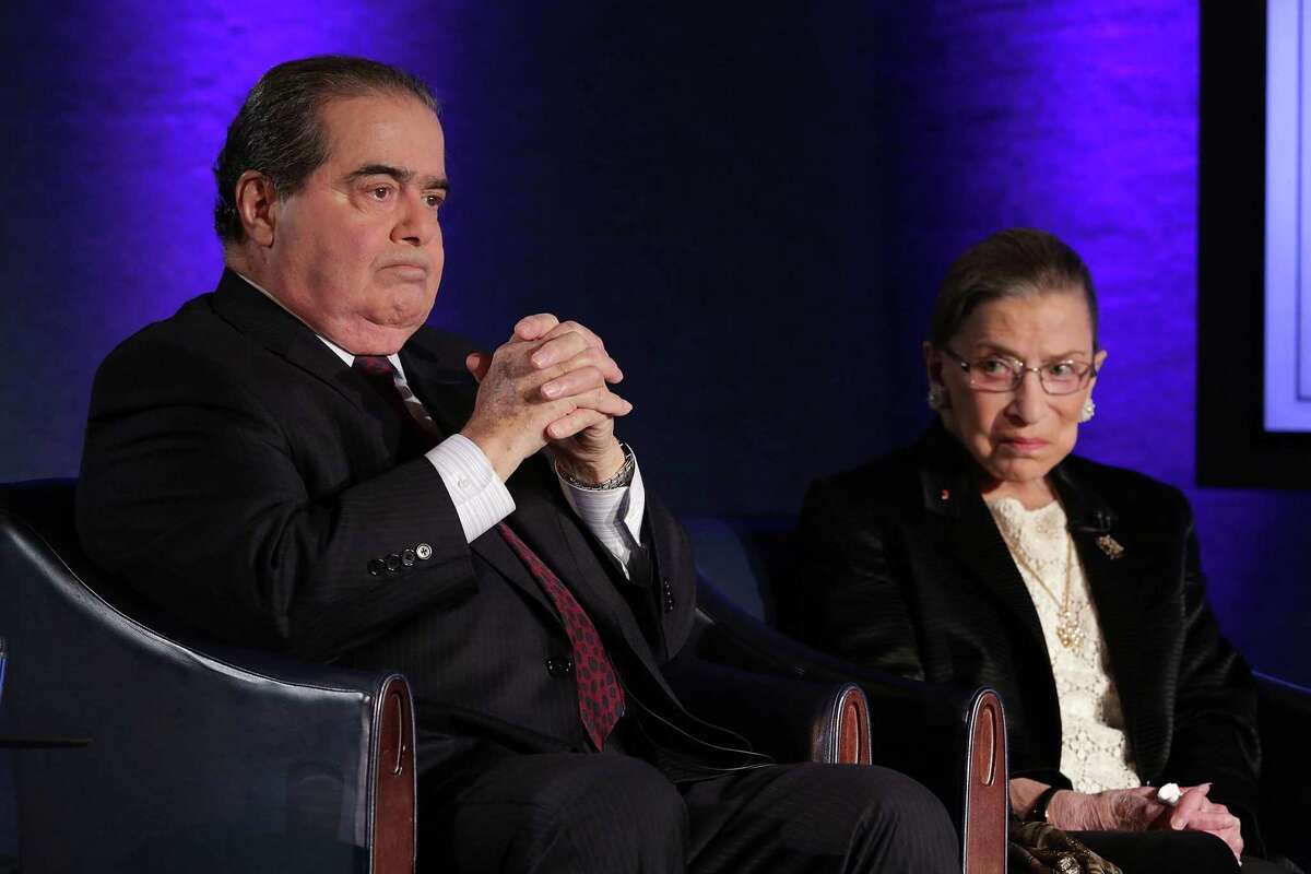 Supreme Court Justices Antonin Scalia, left, and Ruth Bader Ginsburg wait for the beginning of the taping of
