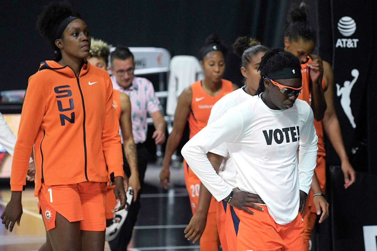 Connecticut Sun players leave the court after losing to the Las Vegas Aces in Game 5 of their semifinal round playoff series Tuesday.