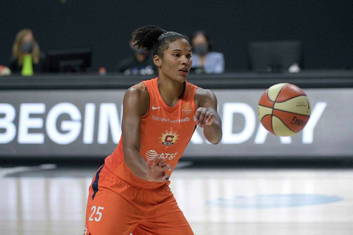 Connecticut Sun forward Alyssa Thomas passes the ball during Game 5 of a semifinal round playoff series against the Las Vegas Aces on Tuesday.
