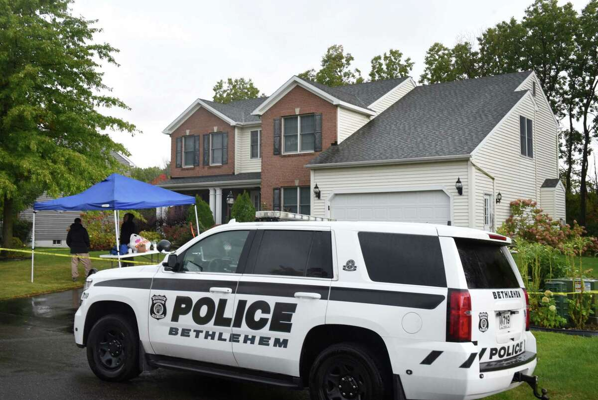 Police investigate the scene of a home at 56 Chesterwood Drive on Wednesday morning, Sept. 30, 2020, in Bethlehem, N.Y., where two people were found dead Tuesday afternoon. The State Police major crime's unit is working with town police on the investigation. (Will Waldron/Times Union)