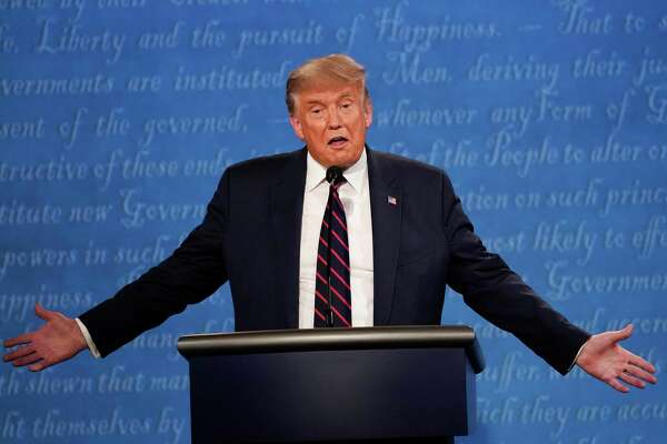 President Donald Trump gestures while speaking during the first presidential debate Tuesday at Case Western University and Cleveland Clinic in Cleveland, Ohio.