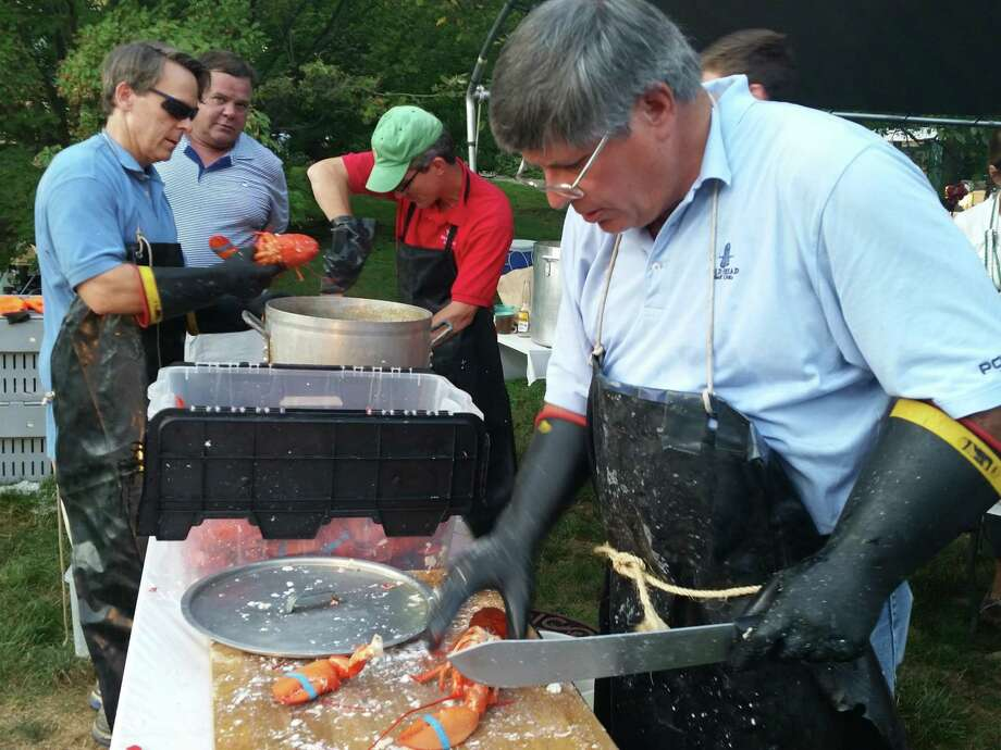 Scott Hobbs and Bill Walbert at the chopping table during a previous New Canaan Rotary Lobsterfest. For the 35th event this year, COVID-19 will prevent Rotary volunteers from preparing the food and will require the Oct. 16-17 event be takeout only. Photo: New Canaan Rotary / Contributed Photo / New Canaan Advertiser Contributed