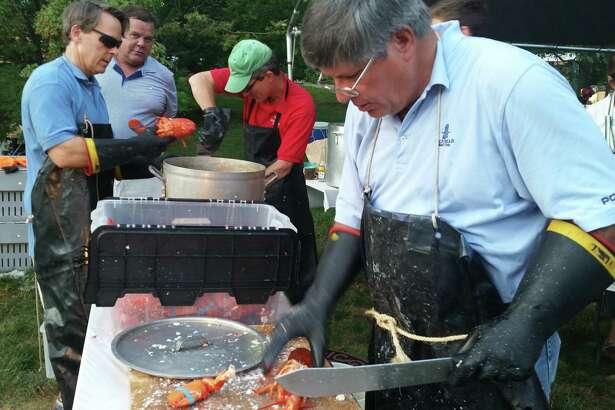 Scott Hobbs and Bill Walbert at the chopping table during a previous New Canaan Rotary Lobsterfest. For the 35th event this year, COVID-19 will prevent Rotary volunteers from preparing the food and will require the Oct. 16-17 event be takeout only.