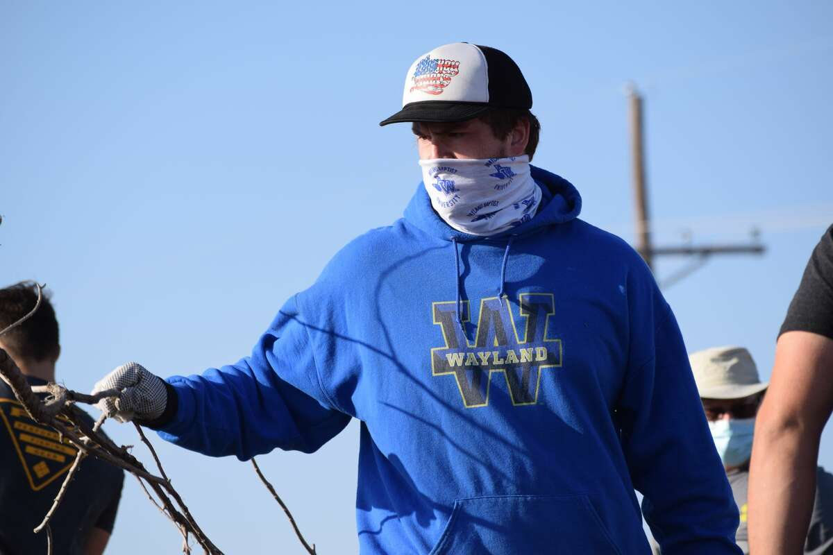 Wayland Baptist University students showed up bright and early Saturday to help clean up Seth Ward.