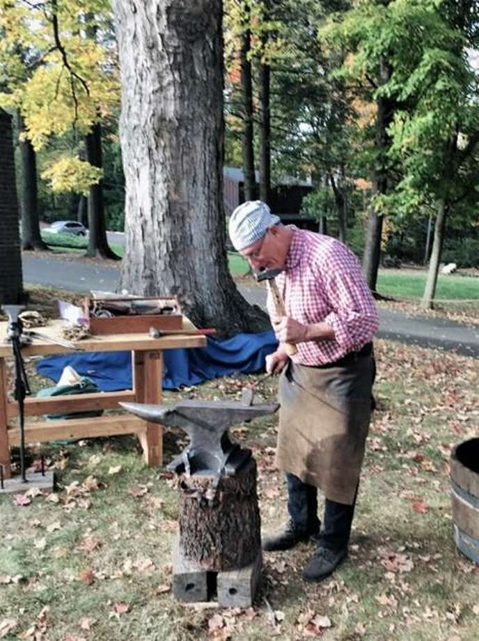 Ralph Lapidus depicts 18th-century blacksmithing in an outdoor family demonstration of the 2017 #HandsonHistory: It Takes A Village exhibition. Photo: Keeler Tavern Museum & History Center
