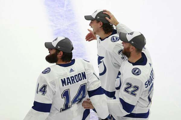 Pat Maroon #14, Kevin Shattenkirk #22 amd Yanni Gourde #37 pf the Tampa Bay Lightning celebrate following the series-winning victory over the Dallas Stars in Game Six of the 2020 NHL Stanley Cup Final at Rogers Place on September 28, 2020 in Edmonton, Alberta, Canada.