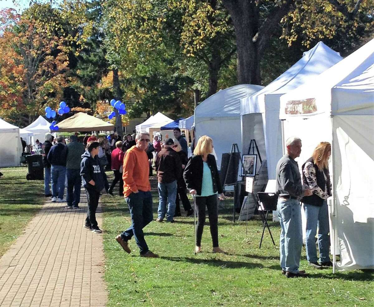 Attendees stroll through the Autumn Arts Festival in Madison last year. This year's event will require the wearing of masks.