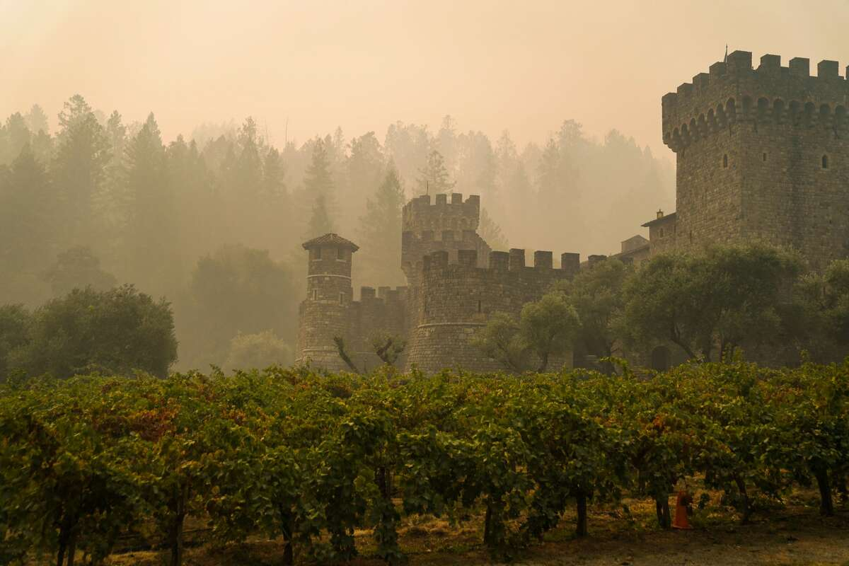 The Castello di Amorosa, sits shrouded in smoke from the Glass Fire in Napa County along CA-128 on Tuesday, Sept. 29, 2020 in Calistoga, CA. The winery was one of many that has suffered losses due to the Glass Fire.