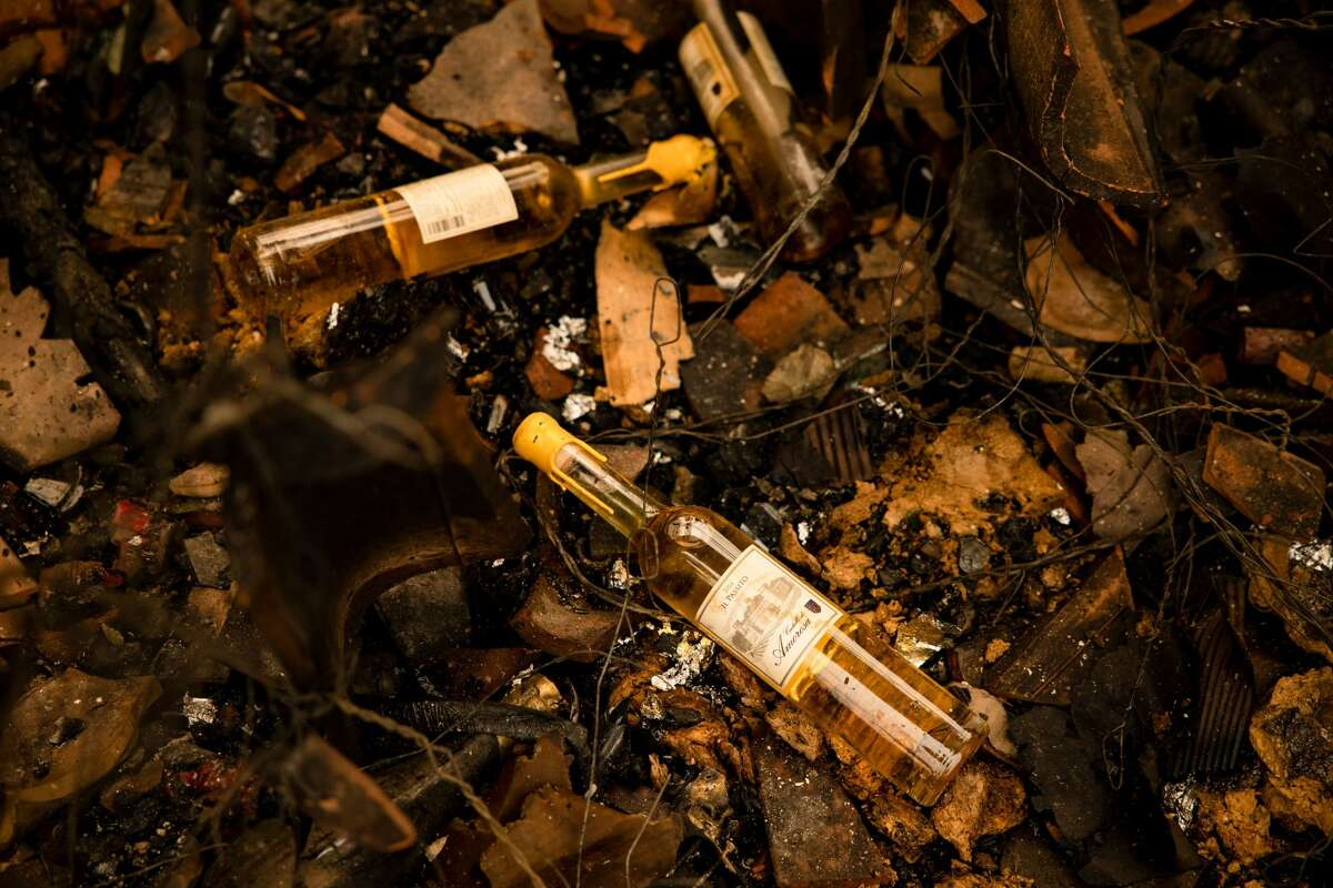 Charred bottles are seen in the remains of the a warehouse in the Farm House at the Castello di Amorosa winery which was gutted by the Glass Fire in Napa Valley, California on September 29, 2020.