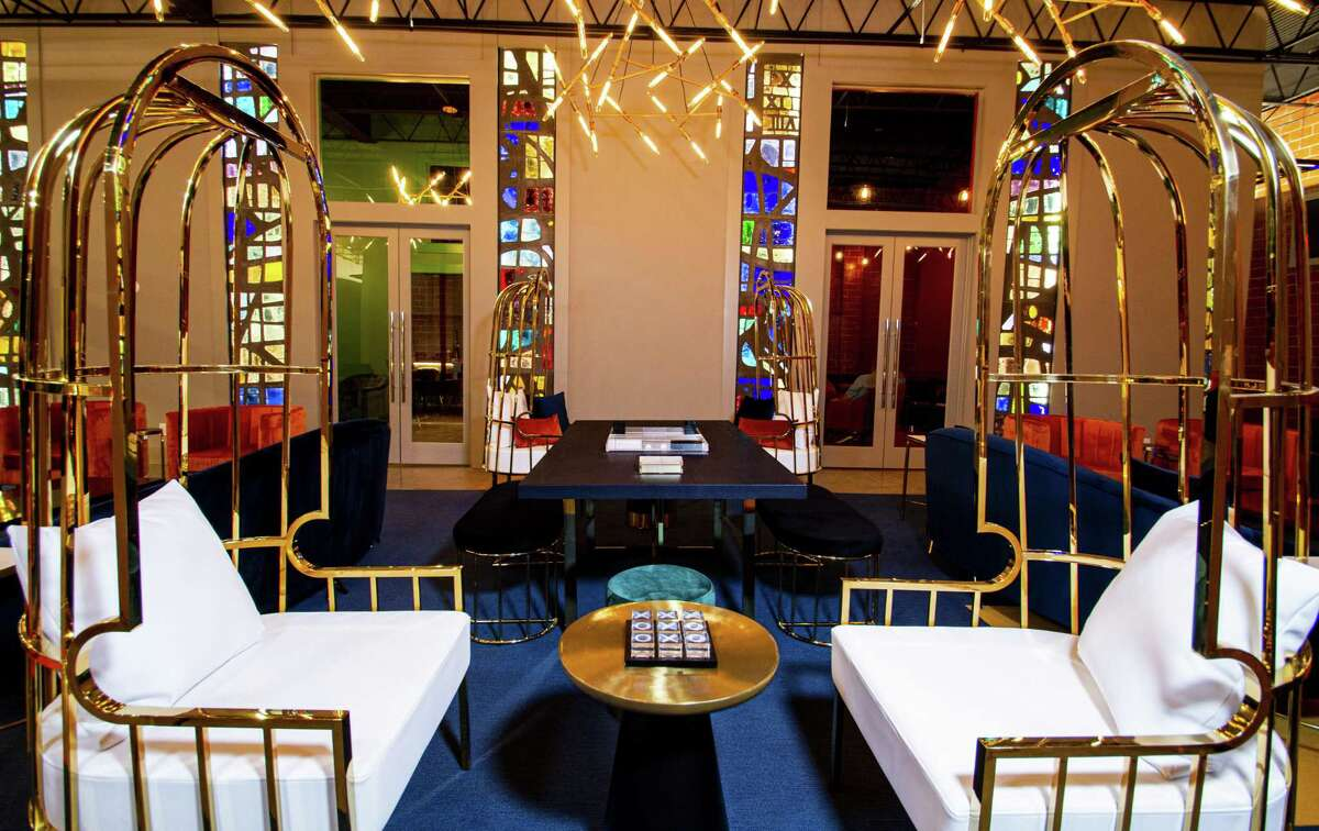Common areas have abstract installations of stained glass salvaged from a demolished Presbyterian church.
