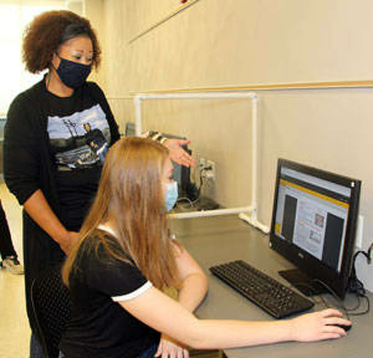 Southwestern Illinois College Associate Professor of English Chantay White-Williams, left, of St. Louis instructs Anastasia Ottinger of Shiloh during her English class. White-Williams was named Full-time Faculty Member of the Year for 2020 by the college Board of Trustees.