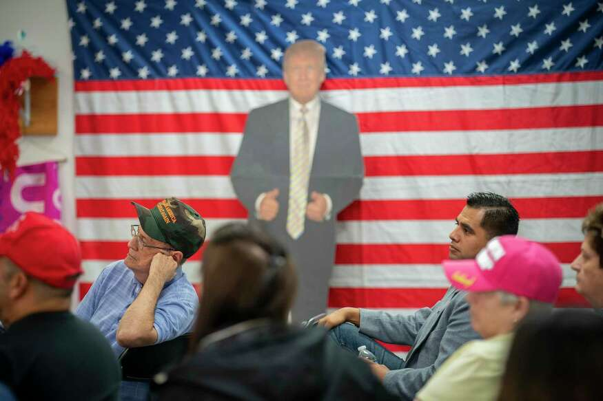 People listen during an event for veterans and second amendment supporters at the Trump campaign office in Katy, TX, Friday, Sept. 25, 2020.