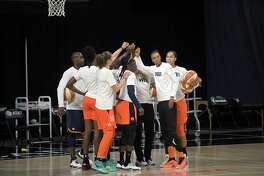 Connecticut Sun players huddle during warmups before Game 5 of their semifinal round playoff series against the Las Vegas Aces on Tuesday.