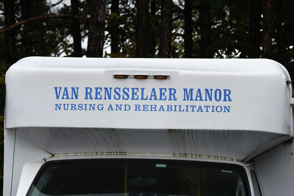 Van Rensselaer Manor transportation vehicles are parked outside the county nursing home on Wednesday, Sept. 30, 2020, in North Greenbush, N.Y. Rensselaer County officials refused to let a state Health Department inspection team into the county nursing home Wednesday saying the inspectors wouldn?•t provide proof they had tested negative for COVID-19. (Will Waldron/Times Union)